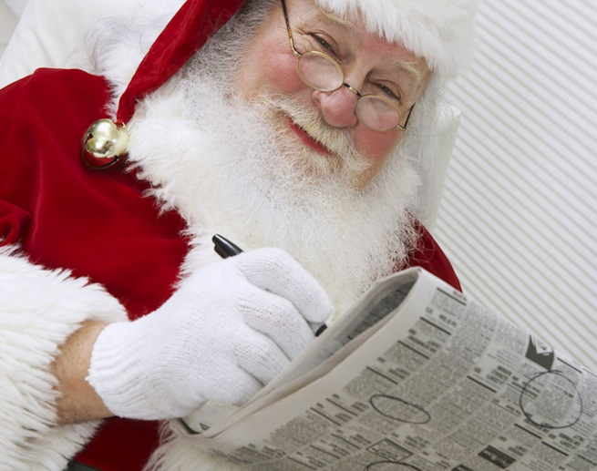 Santa Reading A Newspaper