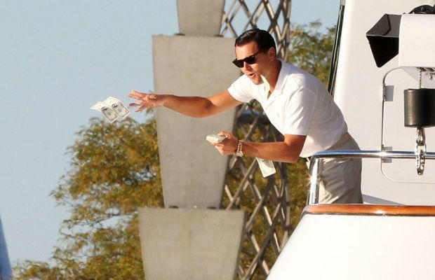 Leonardo DiCaprio throwing money