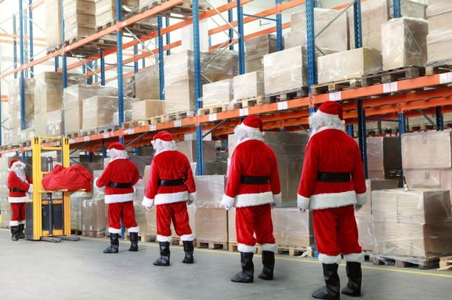 Santas in warehouse