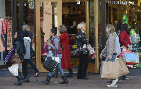 holiday shoppers carrying bags