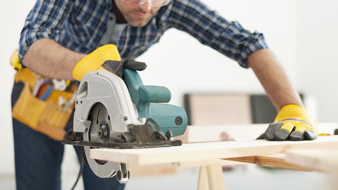 man with circular saw