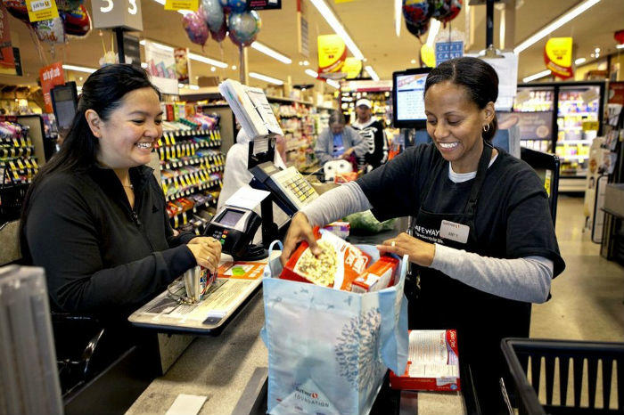 putting groceries in reusable bag