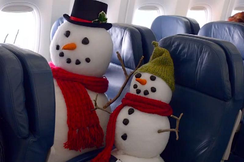 Snowmen in airplane seats